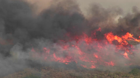 Long-shot of smoky wildfires burning in southern California Footage