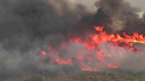 Long-shot of smoky wildfires burning in southern California Stock Video Footage