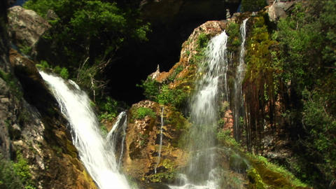 Medium-shot of waterfalls flowing into a pool in Big Sur,... Stock Video Footage