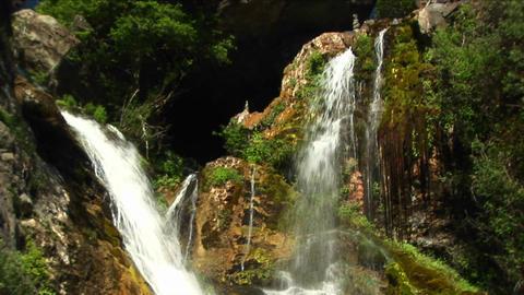 Medium-shot of waterfalls flowing into a pool in Big Sur, California Footage