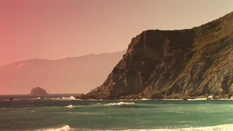Long-shot of waves splashing up along a steep California... Stock Video Footage