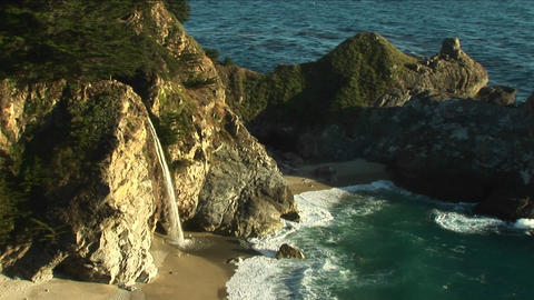 Birds-eye shot of a waterfall crashing down into a... Stock Video Footage
