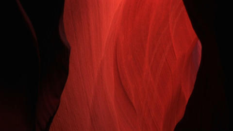Pan-up Of A Glowing Interior Space In Antelope Canyon, Arizona stock footage