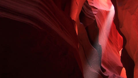 Medium-shot of a light beam illuminating an interior space in Antelope Canyon, Arizona Footage