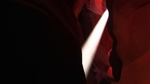 Medium-shot of a light beam illuminating an interior... Stock Video Footage