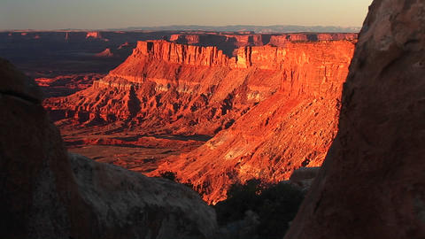 Medium-shot of buttes being bathed in the orange sunset... Stock Video Footage