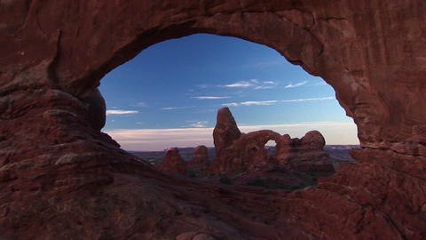 Medium wide shot framed by north arch of Arches National... Stock Video Footage