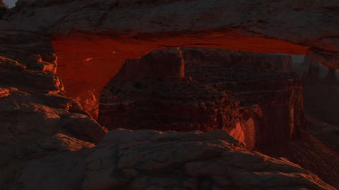 Pan-down of Mesa Arch to reveal and frame distant... Stock Video Footage
