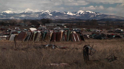 Medium-shot of a car junkyard in front of the scenic... Stock Video Footage