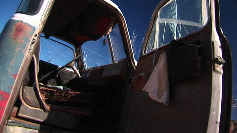 Medium close-up inside the cab of broken-down pickup truck discarded in the Utah desert Footage