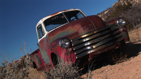 Medium shot of an old rusted pickup in the desert Stock Video Footage