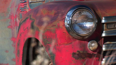 Close-up of headlight and front side of rusted old pickup truck abandoned in Utah desert Footage