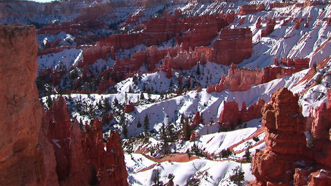 Wide shot of snow covered Claron formations in Bryce Canyon National Park Footage