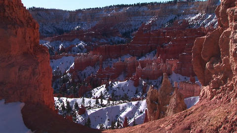 Medium wide static shot of snow captured inside the Claron Formations of Bryce Canyon National Park Footage