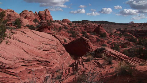 Medium wide shot of Vermilion Cliffs Wilderness with bare eroded sandstone cliffs in the Utah Backco Footage
