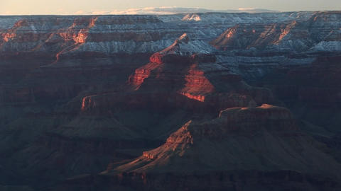 Wide shot of flat-topped rims surrounding the Grand Canyon Footage