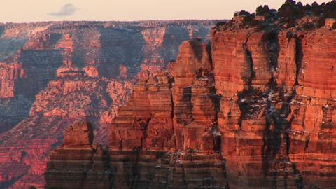 Wide golden-hour shot of Grand Canyon National Park including the layered cliffs of the north rim ca Footage