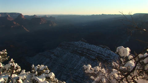 Wide silhouetted background vista of Grand Canyon National Park covered in winter Footage