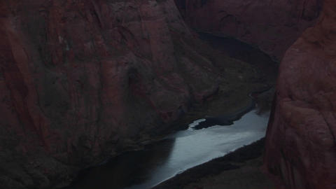 Panning up from frozen Colorado River and sandstone... Stock Video Footage