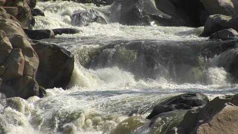 Medium shot of the Kern River rapidly descending a small falls in the Sierra Nevada Mountains Footage