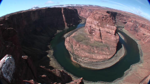 A slow pan across a horseshoe bend in a river Stock Video Footage