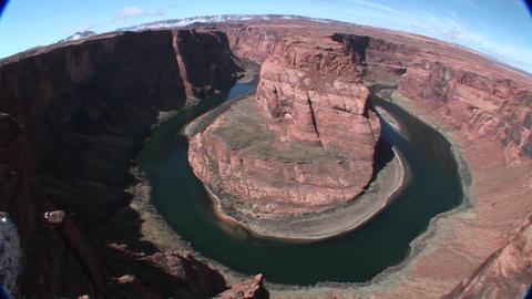 A slow pan across a horseshoe bend in a river Footage