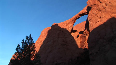 Medium shot of Sandstone Arch in light and shadows in Kodachrome Basin in the Utah Backcountry Footage