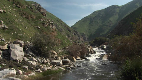 Wide shot of the Kern River Flowing down falls Through a... Stock Video Footage