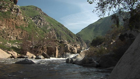 Wide shot of the Kern River flowing from a canyon in the Sierra Nevada Mountains Footage