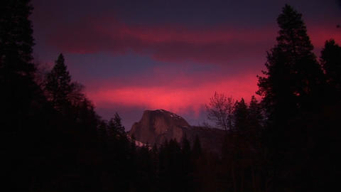 Wide shot of red sky above Half Dome in Yosemite-National-Park Footage