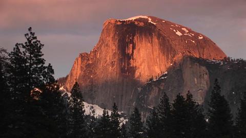 Medium close-up of Yosemite's Half Dome brilliantly lit... Stock Video Footage