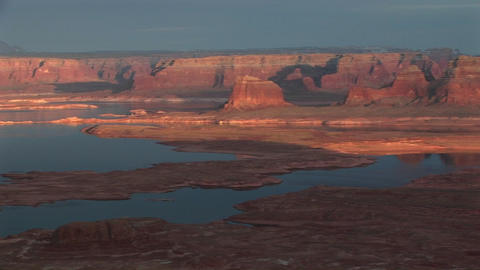 Wide pan-left of Lake Powell's shoreline Live Action