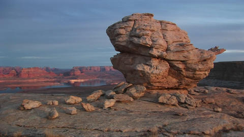 Wide shot of Lake Powell Arizona with close-up of imposing sandstone boulders Footage