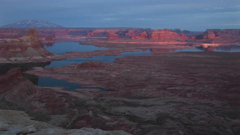 Wide shot of desert and sandstone structures surrounding Lake Powell Footage