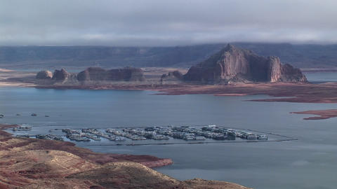 Wide shot above Lake Powell, Arizona with boat docks in foreground Footage
