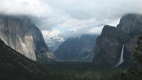 Medium-shot of Yosemite Valley partially veiled under slowly passing clouds Footage