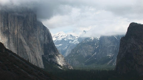Medium-shot Yosemite Valley cloaked in low-hanging clouds Stock Video Footage