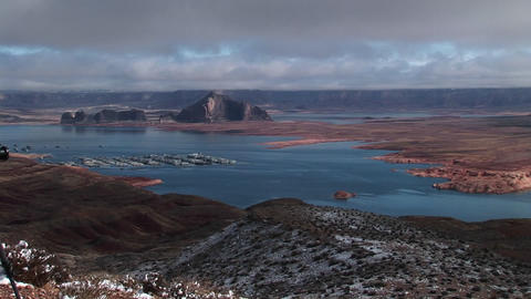 Medium-shot of low clouds hanging over a Lake Powell, Arizona marina Footage