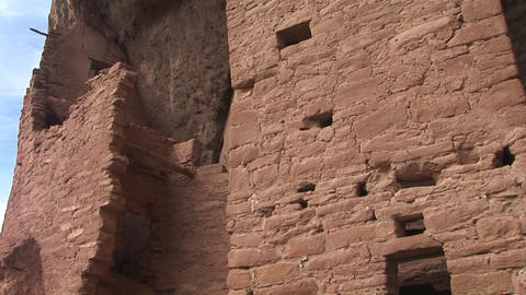 Pan-up of the Native American cliff dwellings at Mesa... Stock Video Footage