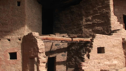 Pan-down to the ruins of Native American cliff dwellings in Mesa Verde National Park Footage