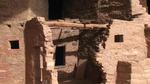Pan-down to the ruins of Native American cliff dwellings... Stock Video Footage