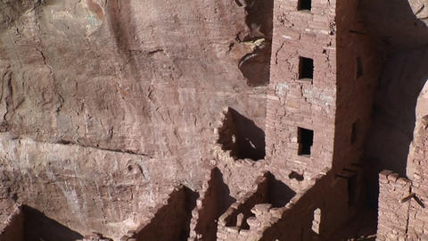 Pan-up of the ruins of Native American cliff dwellings in Mesa Verde National Park Live Action