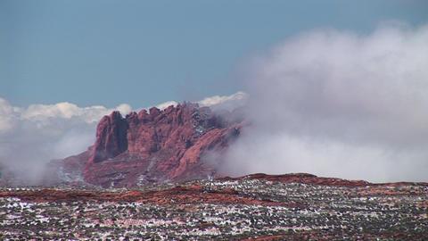 Medium-shot of white clouds enveloping cliffs near Lake... Stock Video Footage