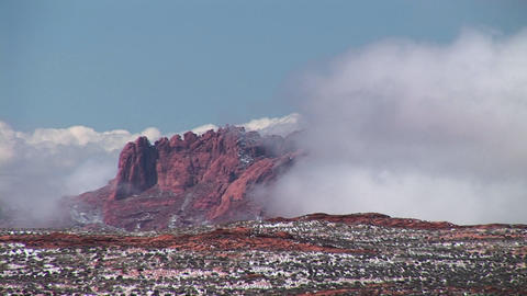 Medium-shot of white clouds enveloping cliffs near Lake Powell, Arizona Footage