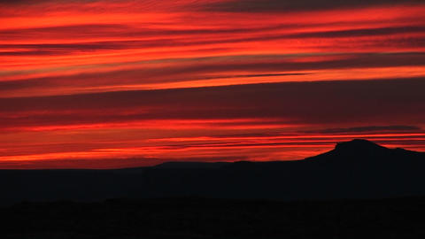 Medium-shot of a brilliant orange sunset over Lake... Stock Video Footage