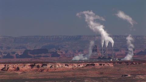 Medium-shot of a factory in the Arizona Desert disgorging... Stock Video Footage
