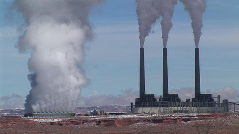 Medium-shot of a factory releasing pollution in the... Stock Video Footage