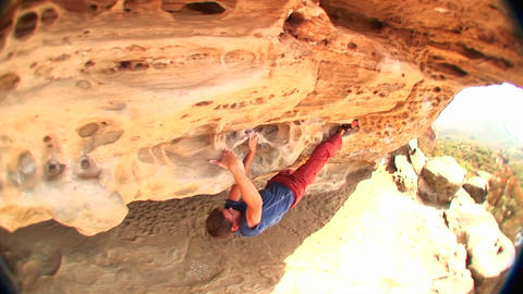 Fish-eye of a boulderer feeling his way along a cliff face Stock Video Footage
