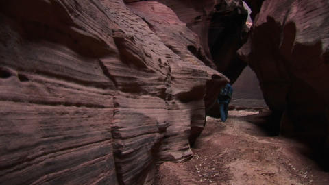 Pan-up of a rock-climber making her way up a granite cliff face Footage