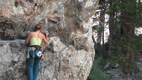Medium-shot of a rock-climber making her way up a granite... Stock Video Footage